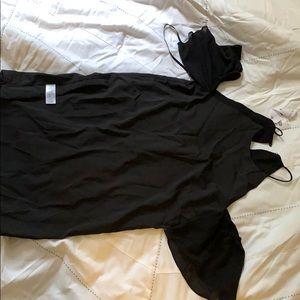 Black dress with shoulder cutouts.
